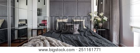 Luxurious Bedroom With Bed, Upholstered Wall And Mirror, Panorama