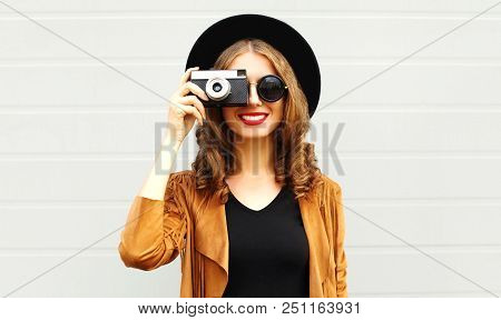 Cool Funny Girl Model With Retro Film Camera Wearing A Elegant Hat, Brown Jacket, Curly Hair Outdoor