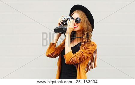 Pretty Elegant Cool Girl With Retro Film Camera Wearing A Elegant Hat, Brown Jacket, In Profile Outd