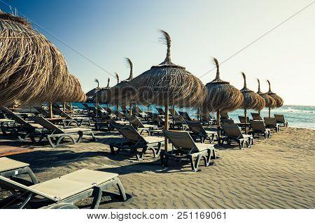 Sun Umbrellas At Torviscas Beach On Costa Adeje In Tenerife Island.