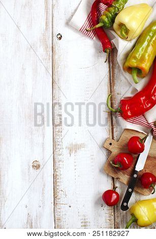 Variety Of Fresh Organic Peppers: Cherry Hot Red Peppers, Long Red And Green Peppers, Sweet Banana P