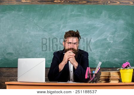 Teacher Bearded Mature Schoolmaster Listening With Attention. Teacher Formal Wear Sit At Table Class