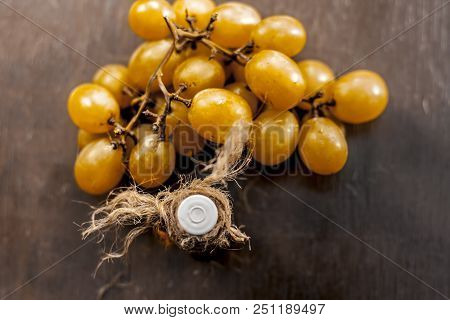 Close Up Of Green Or Yellow Grapes Oil On A Wooden Surface In Dark Gothic Colors.it Is A Good Source