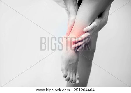 Pain In The Foot, Girl Holds Her Hands To Her Feet, Foot Massage, Cramp, Muscular Spasm, Red Accent