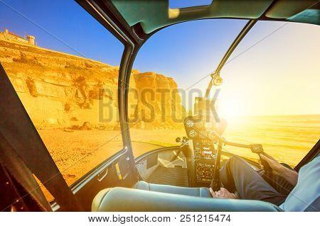 Helicopter Cockpit Interior Flying On Azenhas Do Mar Beach At Sunlight, The Atlantic Ocean In Portug