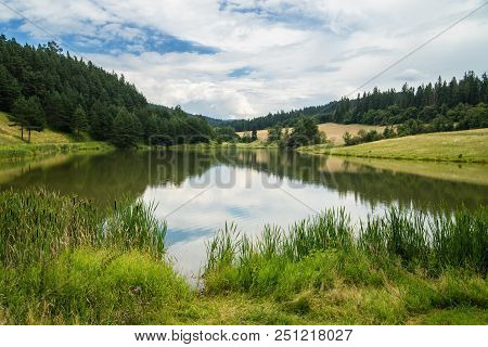 Lake Called Zlatna Surrounded With Meadows And Forest, Levocske Vrchy Mountains, Slovakia.