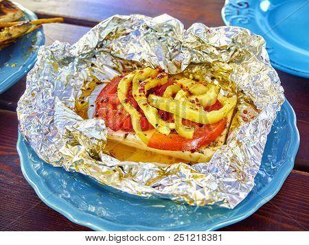 Grilled Feta. Typical Greek Mezze.