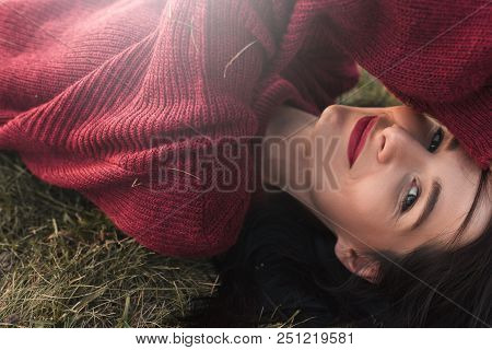 Side View Portrait Of A Beautiful Young Sexy Brunette Woman Smiling, Wearing Knitted Sweater And Loo
