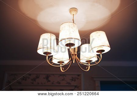 Chandelier On The Ceiling. Warm Light On The Ceiling