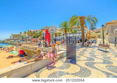 Cascais, Portugal - August 6, 2017: Promenade Along Ribeira Beach On Passeio Dom Luis I Street. Casc