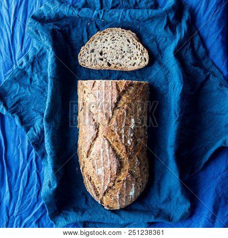 Multigrain Bread On A Blue Wrinkled Table Cloth
