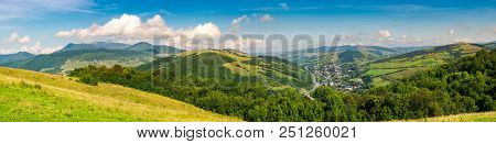 Panorama Of Beautiful Mountainous Rural Area. Village Down In The Valley. Agricultural Fields On Hil