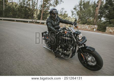 Malaga, Spain - July 15, 2018: Man Riding His Harley Davidson Motorcycle During A Journey Trip Aroun