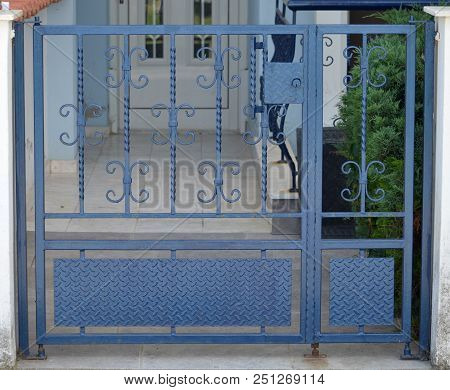 Blue Metal Gate For The Private House