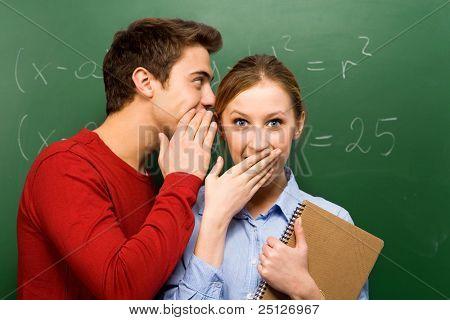Students sharing secrets