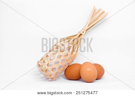 Many Egg (chicken) With Wooden Basket Isolated On White Background - Production Concept.