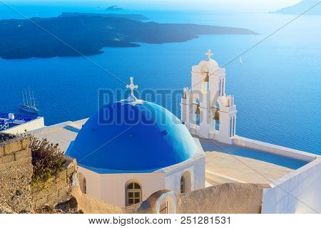 Santorini Island, Greece. Thera (fira) Town Traditional White Houses And Churches With Blue Domes Ov