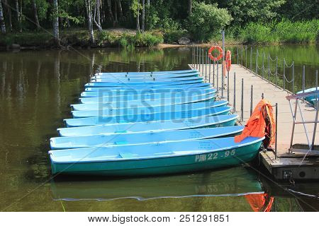 St. Petersburg, Russia - July 15, 2018: Boat Station With Many Boats For Rent On Lake Water. Summer