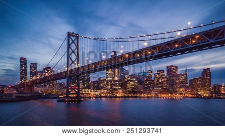 Cityscape View Of San Francisco And The Bay Bridge At Night, California, Usa