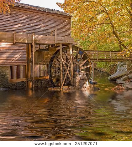 An Old Grist Mill Showing The Water Turning Wheel