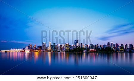 Vancouver Skyline At Dusk As Seen From Stanley Park, British Columbia, Canada