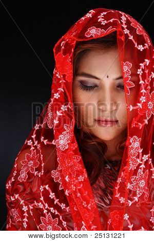 woman in grief and sadness in her traditional clothing