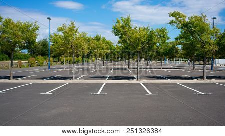 Beautiful Empty Parking Lot With Trees On Sunny Summer Day In France