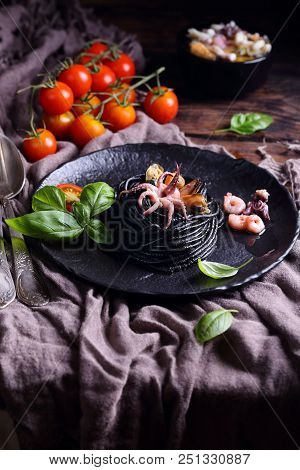 Pasta With Cuttlefish Ink And Seafood And Basil