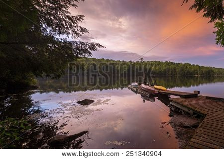 Dock And Lake Under A Colorful Evening Sky - Ontario, Canada