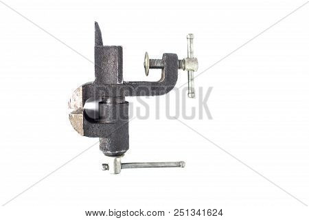 Small black desktop vise, close-up, isolate, vice-grip poster