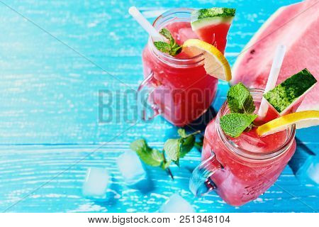 Watermelon Mojito With Mint, Rum, Ice And Lemons With Copyspace, Top View