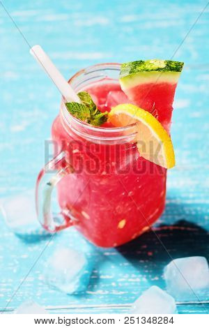 Summer Cold Drink With Watermelon, Mint And Lemon On A Wooden Background Loseup