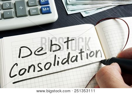 Man Is Writing Debt Consolidation In The Note.