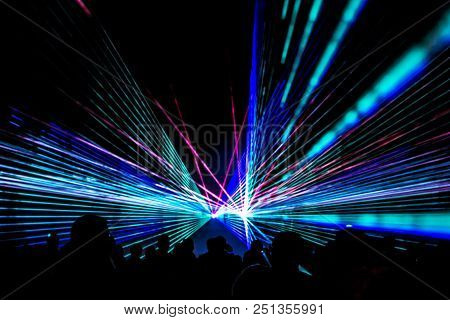 Colorful Laser Show Nightlife Club Stage With Party People Crowd. Luxury Entertainment With Audience