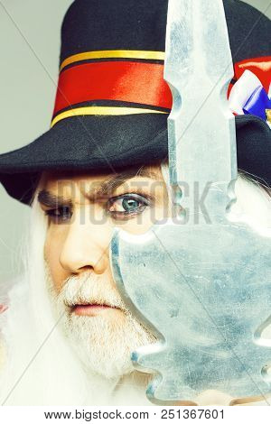 Frown Senior Man Bearded Beefeater Yeomen Warder Or Male Royal Guard Bodyguard In Hat With Spear On