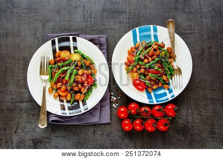 Flat-lay Of Vegan Beans Salad In Plates With Micro Greens, Tomatoes And Aspargus. Healthy Energy Boo