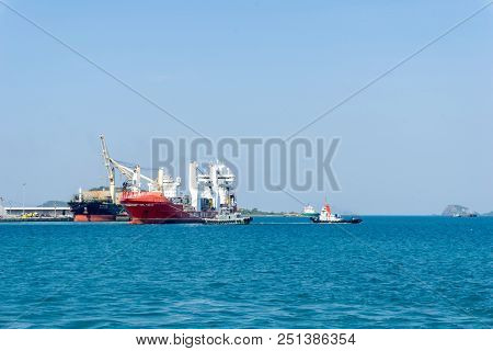 Chonburi, Thailand - April 9, 2018 : Large Cargos Heavy Lift Ship Leaves Port With Supported By Two