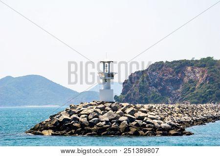 An Active White Pile Beacon On The Rock Breakwater Near Shore In Chuk Samet Port, Sattahip District,