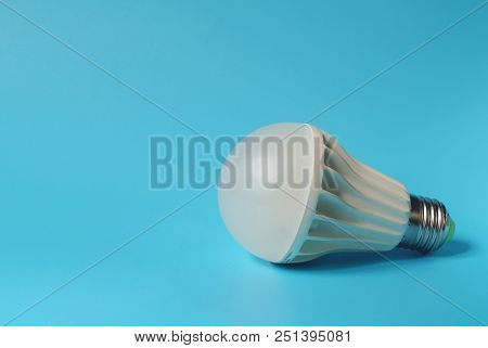 Led Lamp On Blue Background. Save On Energy And Your Money With Progressive Technology.