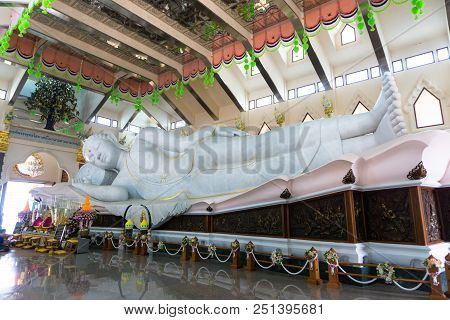 Udonthani, Thailand - March 17, 2018 : Gigantic White Marble Reclining Buddha In Buddhism Sacred Hal