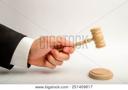The Referee's Hand Is Going To Be Hit With A Hammer And Render A Verdict In Court. Court And Court C