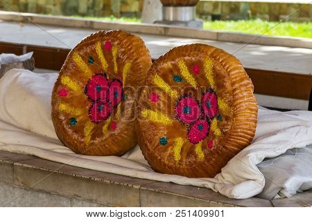 National Festal Uzbek Bread Sold In The Market - Samarkand, Uzbekistan. There Are Two Types Of Uzbek