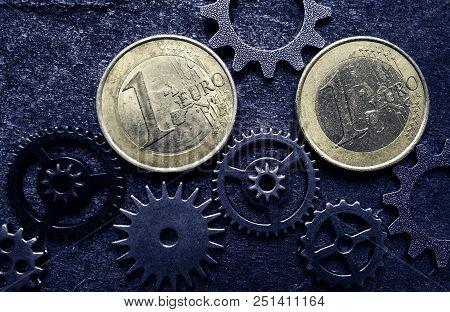 Euro Coins And Assorted Gears - Eu Economy Concept