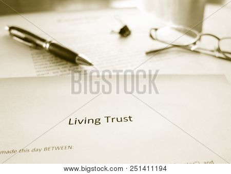A Living Trust Legal Document With Pen And Glasses