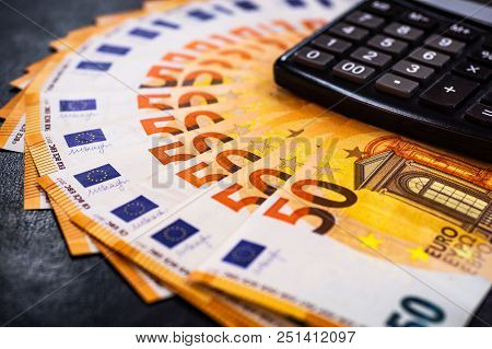 Euro Money. Euro Cash Background. Lots Of Euro Money On The Calculator. Euro Banknotes Background Of
