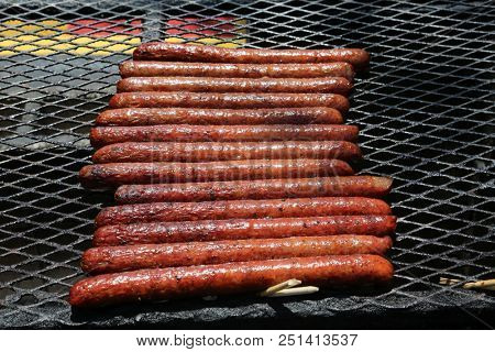 Sausages on the grill. Barbecue Grill with sausage links. hot and sweet German bratwurst sausages on the grill. Italian sausages on a Hot Fire Grill . Sausage Links for lunch.