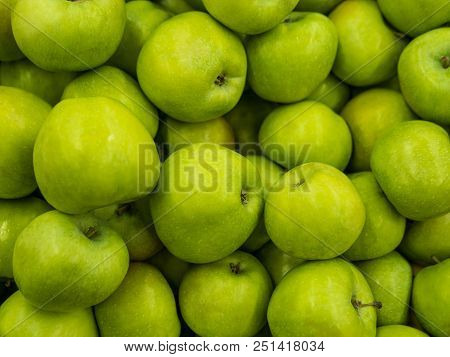 Green Apples. Fitness Diet Detox Concept. Green Fresh Apples Harvests Close Up. A Backdrop Of Green