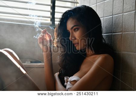 Smoking Concept. Sexy Women Are Smoking In The Room. Sexy Women Are Relaxing By Smoking. Beautiful W