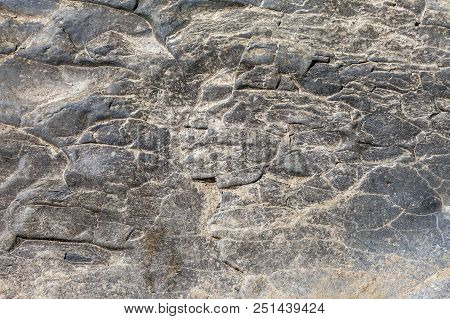A Relief Ornamental Texture On A Cliff Face. Photo Shows A Stone Texture. The Texture Of The Stone,