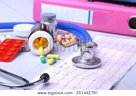 Close-up Stethoscope Lying On Rx Prescription With Assorted Pills. Healthy Life Or Insurance Concept